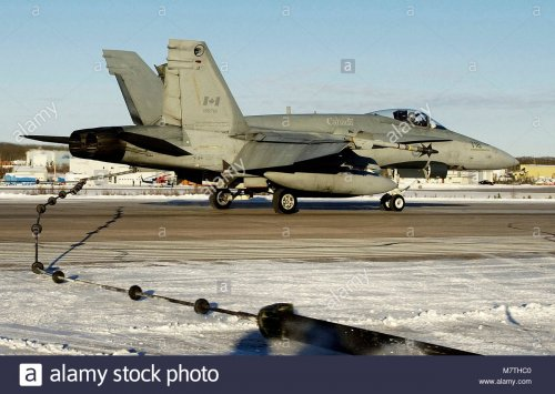 cf-18-hornet-engaging-cable-the-pilot-of-this-cf-18-hornet-skillfully-M7THC0.jpg
